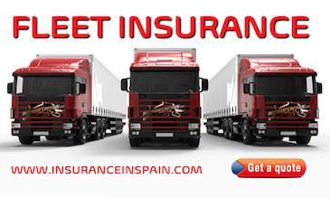 A fleet of red lorries promoting fleet insurance for www.insuranceinspain.com